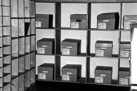 New Zealand Sugar Co archive boxes on shelve.