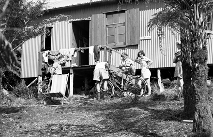 Trampers outside the Auckland Tramping Club's hut Ngare Te Kotare, Anawhata, 1945.