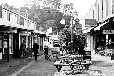People strolling along Albany village.